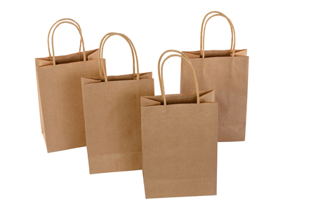 Brown paper shopping bags on white background. Empty area. Archivio Fotografico - 106235695