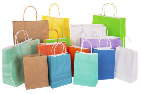 Variety of colored paper shopping bags on white background. Empty area. Archivio Fotografico - 106235697