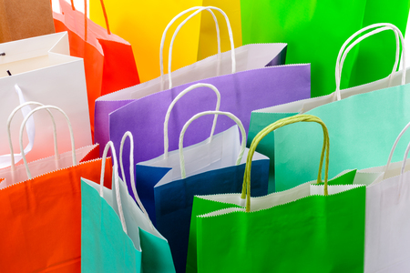 Variety of colored paper shopping bags on white background. Empty area. Archivio Fotografico - 106235698
