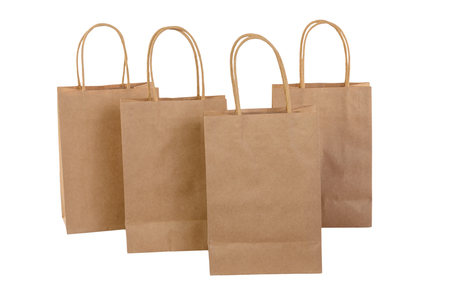 Variety of colored paper shopping bags on white background. Empty area. Archivio Fotografico - 106235701