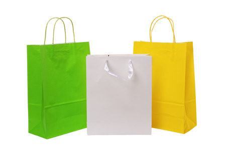 Variety of colored paper shopping bags on white background. Empty area. Archivio Fotografico - 106235703