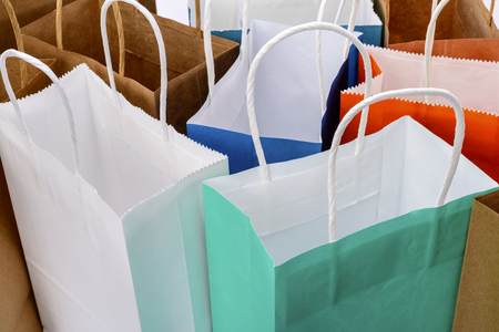 Variety of colored paper shopping bags on white background. Empty area. Archivio Fotografico - 106235707