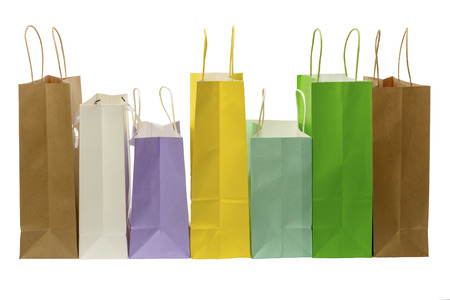 Variety of colored paper shopping bags on white background. Empty area. Archivio Fotografico - 106235709