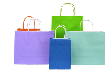 Variety of colored paper shopping bags on white background. Empty area. 스톡 콘텐츠