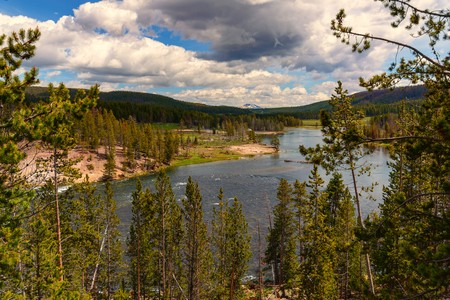Landscape of the valley with view of the Yellowstone River inside the national park. Archivio Fotografico - 106235408