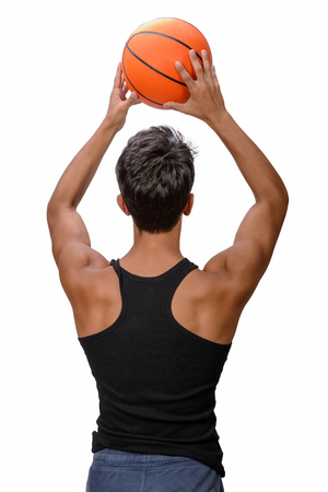Portrait of a young basketball player passing the ball. Young caucasian boy in sportswear playing basketball on white background with copyspace Archivio Fotografico - 106235272