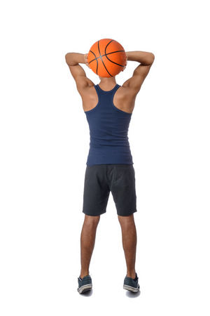 Portrait of a young basketball player passing the ball. Young caucasian boy in sportswear playing basketball on white background with copyspace Archivio Fotografico - 106235276