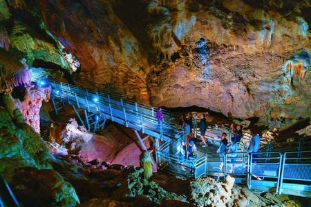 Fluminimaggiore, Sardinia, Italy - August 07, 2018: Tourists visit the cave of 에디토리얼