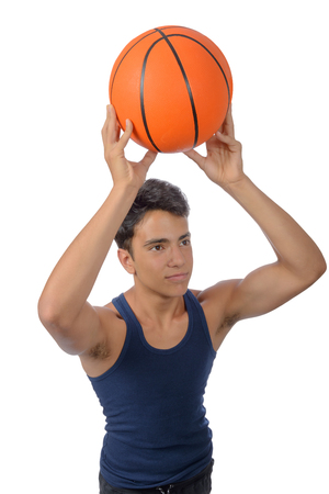 Portrait of a young basketball player passing the ball. Young caucasian boy in sportswear playing basketball on white background with copyspace Archivio Fotografico - 106235186