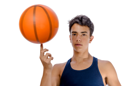 Portrait of a young basketball player passing the ball. Young caucasian boy in sportswear playing basketball on white background with copyspace Archivio Fotografico - 106235190