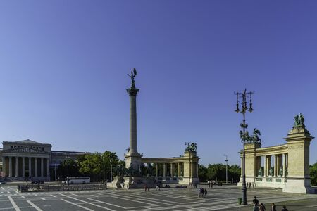 Budapest, Hungary - July 04, 2019: Heroes Square with Millenium Memorial and the horseman Memorial is one of the major squares in Budapest. Panorama with tourists and visitors.