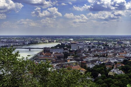 Panorama of Budapest over the Danube river. The bridges destroyed in World War II touch the two parts of the city Buda and Pest. The bridges stand out for their majesty and elegance. Stock fotó
