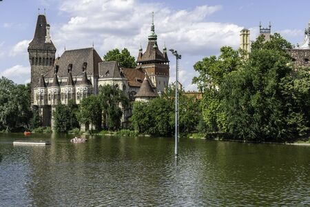 Budapest, Hungary - July 04, 2019: The Vajdahunyad castle, built to celebrate the Millennium, perfectly illustrates the different architectural styles that characterize Hungary. It is partly inspired by the castle of Honedoara (Transylvania, Romania).