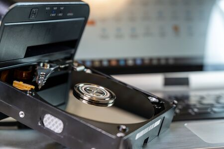 Technical laboratory for hard disk repair and data saving. Rotating disks of the Hard Disk with reflections.