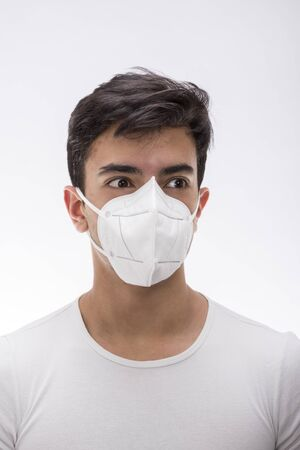 Young boy wearing surgical mask, various facial expressions, portrait, high section. White background. Stock Photo