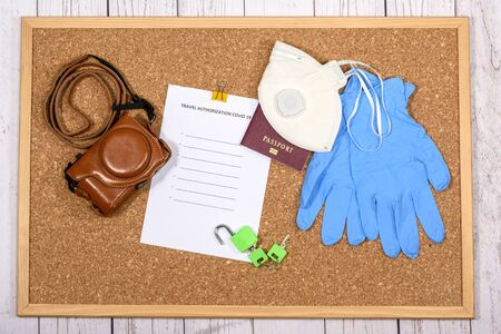 Coronavirus organize for travel with authorization and equipment. Memos and notes. Stock Photo