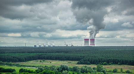 Steam clubs rise above the cooling system of the newly constructed units of Novovoronezh nuclear power plant NPA-2