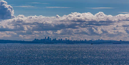 scapes: blue landscape with sea, clouds and and city scapes Stock Photo