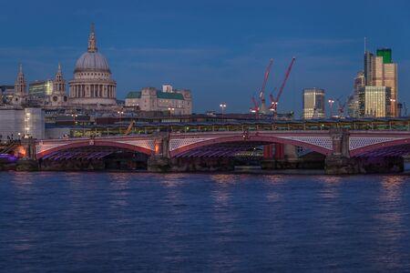 Blackfriars Bridge and St Pauls cathedral at night Stock Photo