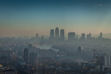 view of London and Thames river on sunny day with smog Stock Photo