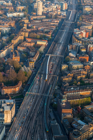 A view from the top of London bridge railway tracks during sunset
