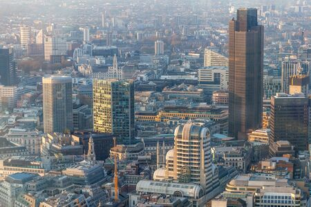 a view of city of London during sunset with yellowish light