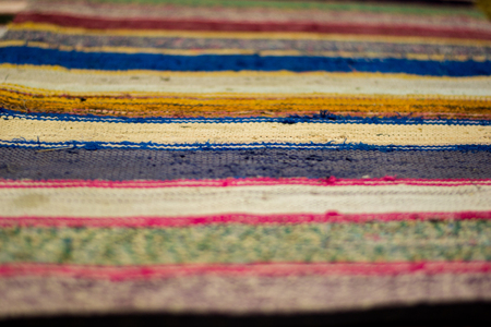Colored striped traditional color carpet in home Stock Photo