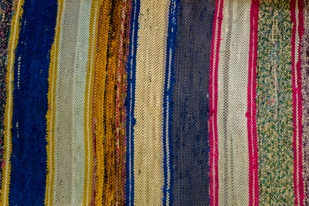 rug texture: Colored striped traditional color carpet in home Stock Photo