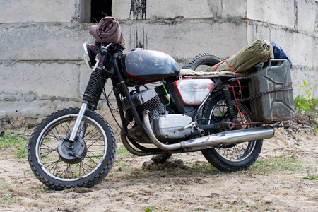 A post apocalyptic motorcycle near destroyed building Stock Photo