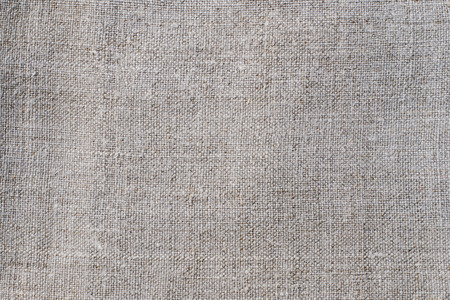 Texture of an light linen cloth, background