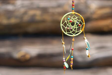 goodluck: Dream catcher in the wind on a wooden background