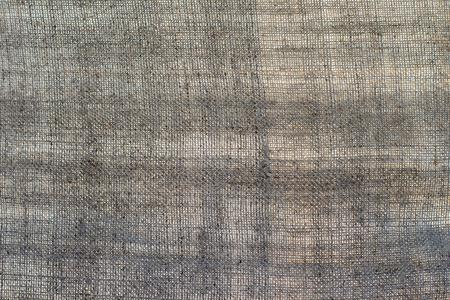 Texture of an dark linen cloth, background Imagens