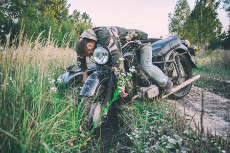 Drunk man in a motorcycle with a sidecar got stuck on the road Reklamní fotografie