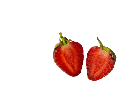 vitamine: Two halves of a ripe strawberry isolated on a white background