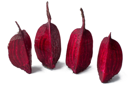 Cut into four pieces red beet isolated on white background