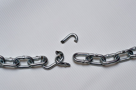 Photo of broken metallic chain on white background Stock Photo