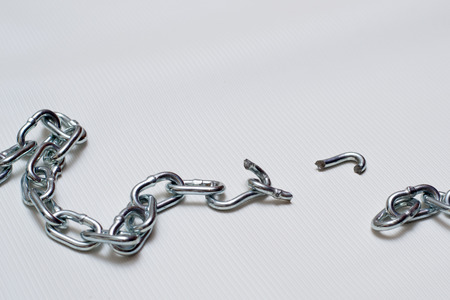 Photo of broken metallic chain on white background Stock Photo