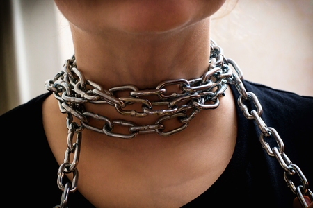 Photo of hands releasing the neck from a chain