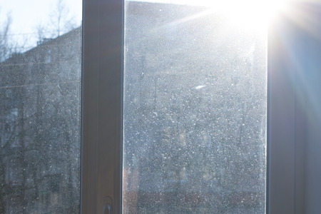 Window with very dirty and dusty glass in daylight
