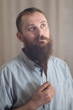 Portrait of a serious man with a long beard Imagens