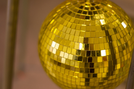 Golden mirror disco ball on a dark background, close-up Banco de Imagens