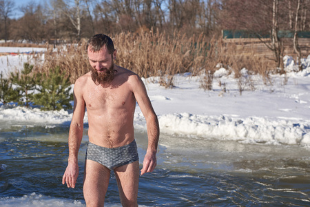 A man after diving into icy water on a Christian winter holiday Foto de archivo