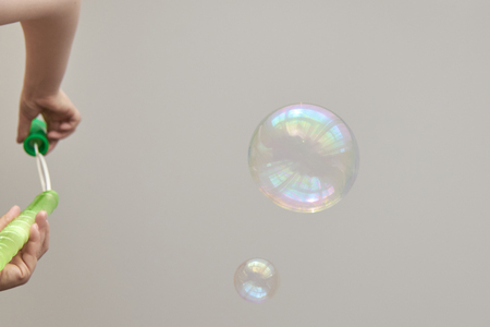 Photo of multi-colored soap bubbles, creative background, selective focus Stock Photo