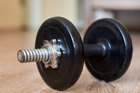 Dumbbell on the floor at home, home sports, healthy lifestyle, close-up Reklamní fotografie