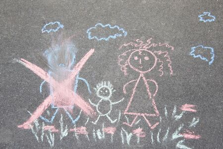 Childrens drawing with chalk on the asphalt, family with no dad: crossed out dad, mom and baby. Family divorce topic.