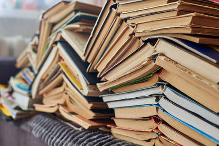 Old books piled up in a heap, close-up, learning and education concept.