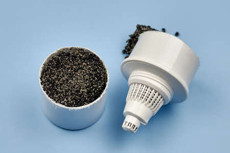 Internal component of a water filter element for home use on a blue background, close-up.