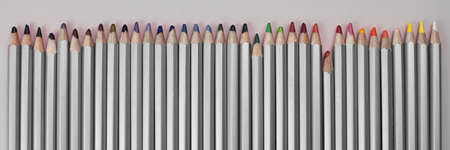 Colored pencils lined up in a row, the theme of creativity and hobby. 免版税图像