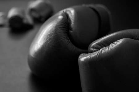 Leather boxing gloves, close-up, black and white photo. Banco de Imagens