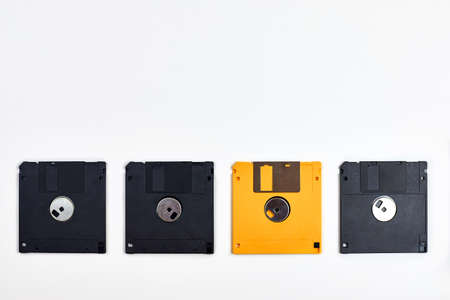 Several floppy disks of different colors on a white background, technologies of the past. Banco de Imagens